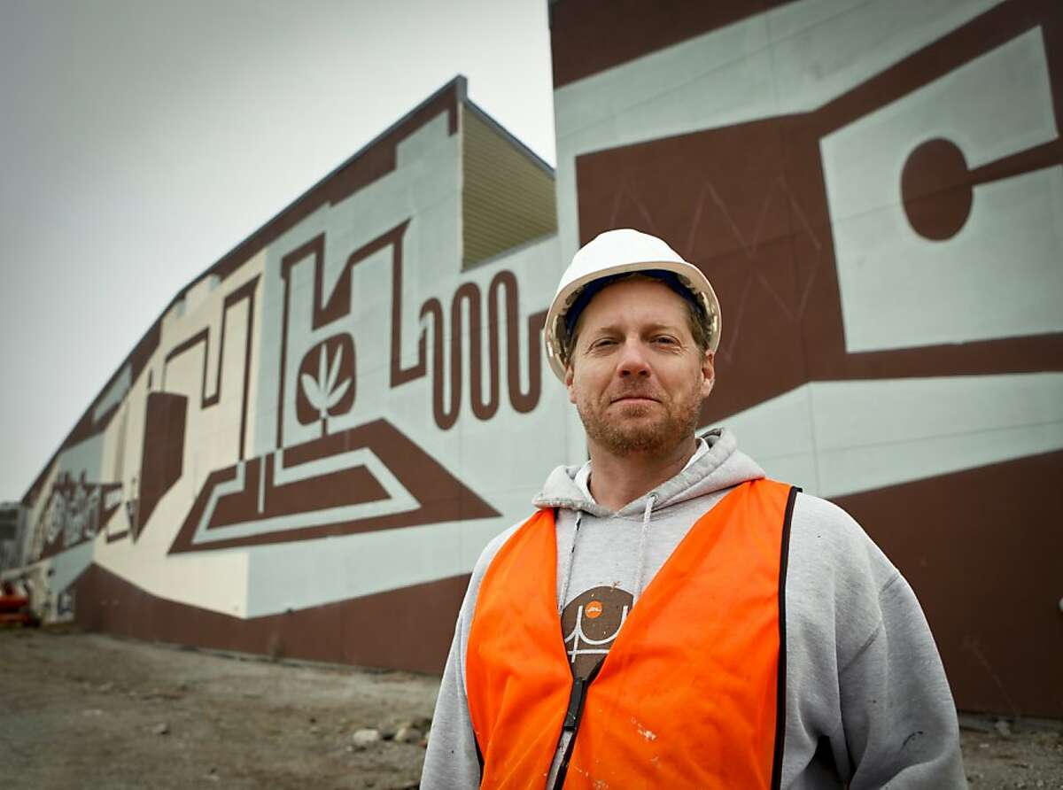 Brian Barnelco, seen on Tuesday, Aug. 30, 2011 in San Francisco, Calif., is working on a 600-foot panoramic painting called,