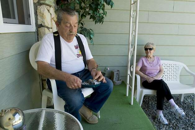 Philip Medeiros smokes on the porch of their home with his wife Margaret, Thursday Aug. 18,  2011. Margaret is concerned that Philip's cardiologist has been urging him to get an angiogram every time he goes in to visit, even though Philip doesnêt have any angina symptoms or shortness of breath. Philip goes to the cardiologist at least three times a year and has refused angiograms during his last two visits. Photo Brian Baer Photo: Brian Baer, Special To The Chronicle