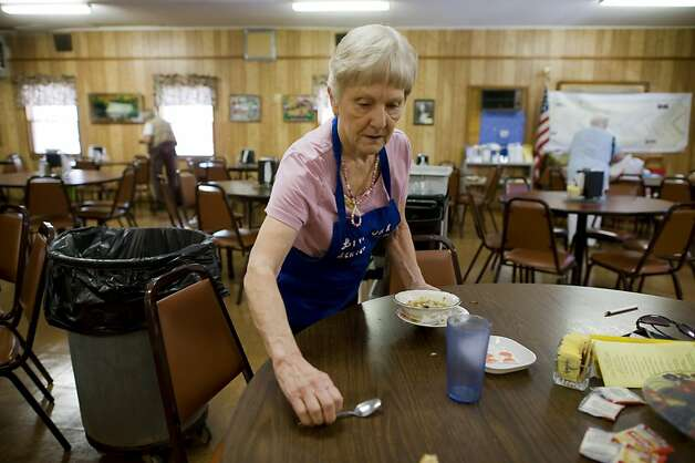 Margaret Medeiros works to clean tables after lunch service at the Live Oak Senior Center where she volunteers, Thursday Aug. 18,  2011. Margaret is concerned that her husband's cardiologist has been urging him to get an angiogram every time he goes in to visit, even though Philip doesnêt have any angina symptoms or shortness of breath. Philip goes to the cardiologist at least three times a year and has refused angiograms during his last two visits. Photo Brian Baer Photo: Brian Baer, Special To The Chronicle