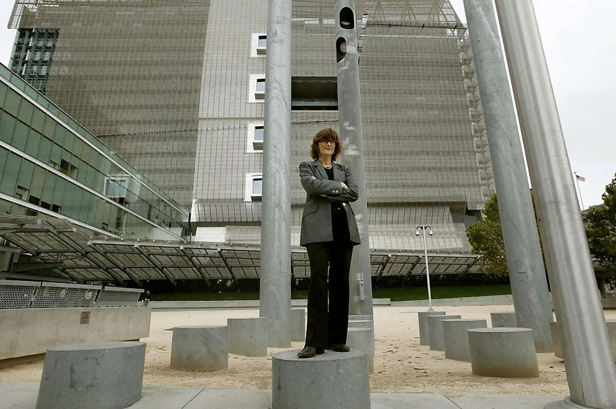 Eve Hinman, stands a top one of the many decorative bollards that surround the outside of the San Francisco Federal Building, San Francisco, Ca. on Thursday August 11, 2011, which she helped design to be able to withstand a terrorist attack. Hinman has established standards for the U.S. Department of State , U.S. General Services Administration, Federal Emergency Agency and the Federal Bureau of Investigation, she leads the Hinman Consulting Engineers in San Francisco.
