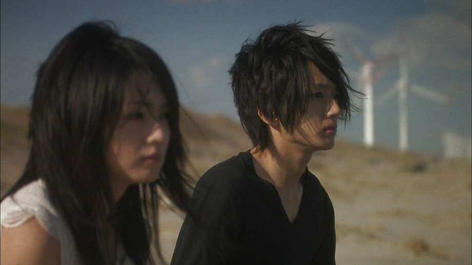 "Hikari Mitsushima, left, and Takahiro Nishijima  appear in a scene from, ""Love Exposure."" Photo: Olive Films"