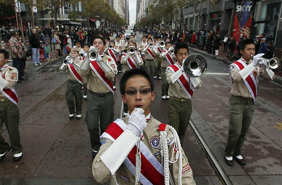 Members of the Boy Scout Troop 12 marching band, play for the crowds during the annual Veteran's Day parade up Market Street on Friday November 11, 2011 in San Francisco, Ca.  Ran on: 11-12-2011 The Boy Scout Troop 12 marching band performs on Market Street in the annual Veterans Day parade. Photo: Michael Macor, The Chronicle