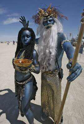 Ayanna and Poseidon from San Diego together walk the playa in the afternoon at Burning Man at Black Rock, NV., on September 3, 2009.