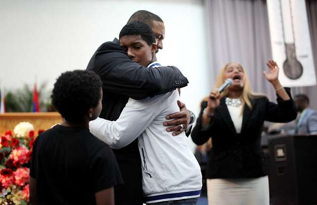 Pastor Mark Jackson embraces Jacob Knight,15, with his wife Desiree,R during a worship service at the True Love Worship Center in Van Nuys, CA on Sunday, July 31, 2011.  Mark Jackson is the new head coach of the Golden State Warriors.(Photo by Sandy Huffaker for the SF Chronicle) Photo: Sandy Huffaker, San Francsico Chronicle