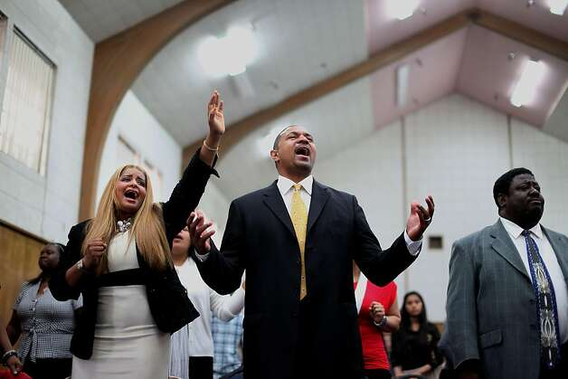 Pastor Mark Jackson sings gospel hymns with wife Desiree,L, and other congregants during a worship service at the True Love Worship Center in Van Nuys, CA on Sunday, July 31, 2011.  Mark Jackson is the new head coach of the Golden State Warriors.(Photo by Sandy Huffaker for the SF Chronicle) Photo: Sandy Huffaker, San Francsico Chronicle