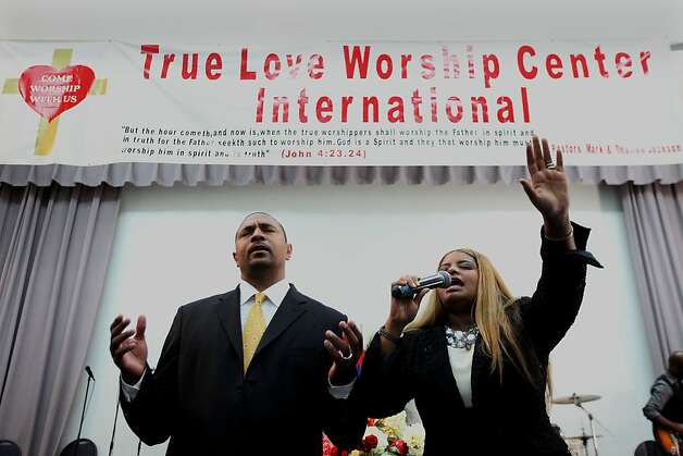 Pastor Mark and Desiree Jackson lead a prayer during a worship service at the True Love Worship Center in Van Nuys, CA on Sunday, July 31, 2011.  Mark Jackson is the new head coach of the Golden State Warriors.(Photo by Sandy Huffaker for the SF Chronicle) Photo: Sandy Huffaker, San Francsico Chronicle