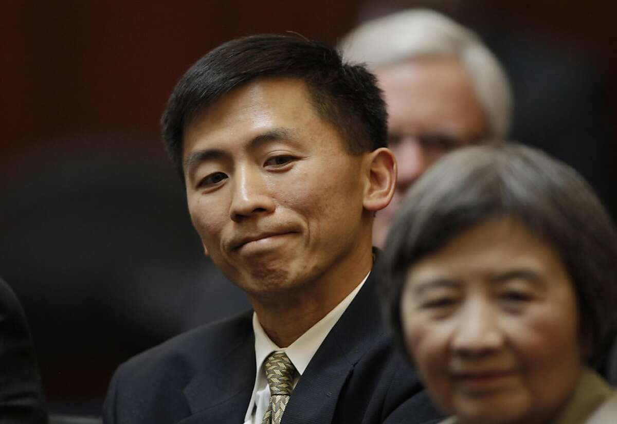 University of California, Berkeley law professor Goodwin Liu appears during his nomination hearing before a three member appointment board of the Commission on Judicial Appointments in San Francisco, Wednesday, Aug. 31, 2011. Lower right is his mother Yang Ching Liu. (AP Photo/Paul Sakuma)