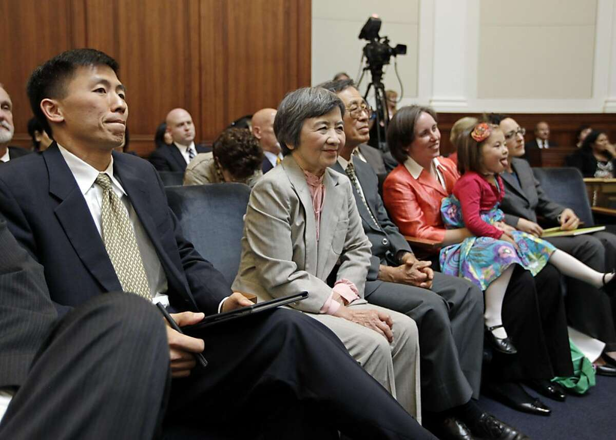 University of California, Berkeley law professor Goodwin Liu, far left, appears before the California State Supreme Court during a confirmation hearing on Wednesday, Aug. 31, 2011 in San Francisco. With Liu from left to right are, mom Yang Ching, dad Wen Pen, wife Ann O'Leary-Liu holding daughter Violet O'Leary-Liu, 4,Liu's nomination has met with some Republican opposition, but the Commission on Judicial Appointments is expected to confirm him. President Obama nominated Liu to the federal appeals court, but Liu withdrew from consideration after it became clear key Republican senators were blocking his name from coming to a vote. (AP Photo/Paul Sakuma)