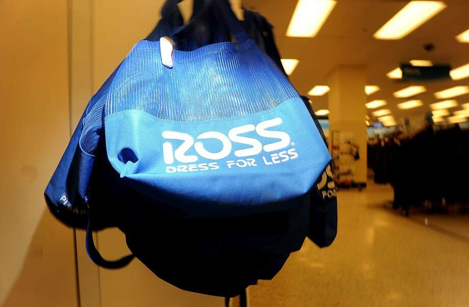 Shopping bags hang at a Ross store in San Francisco, California, U.S., on Wednesday, Aug. 31, 2011. Photographer: Noah Berger/Bloomberg  Ran on: 09-02-2011 Photo caption Dummy text goes here. Dummy text goes here. Dummy text goes here. Dummy text goes here. Dummy text goes here. Dummy text goes here. Dummy text goes here. Dummy text goes here.###Photo: ross02_ph21314662400###Live Caption:Shopping bags hang at a Ross store in San Francisco, California, U.S., on Wednesday, Aug. 31, 2011.__Photographer: Noah Berger-Bloomberg###Caption History:Shopping bags hang at a Ross store in San Francisco, California, U.S., on Wednesday, Aug. 31, 2011.__Photographer: Noah Berger-Bloomberg###Notes:Inside A Ross Dress For Less###Special Instructions: Photo: Noah Berger, Bloomberg