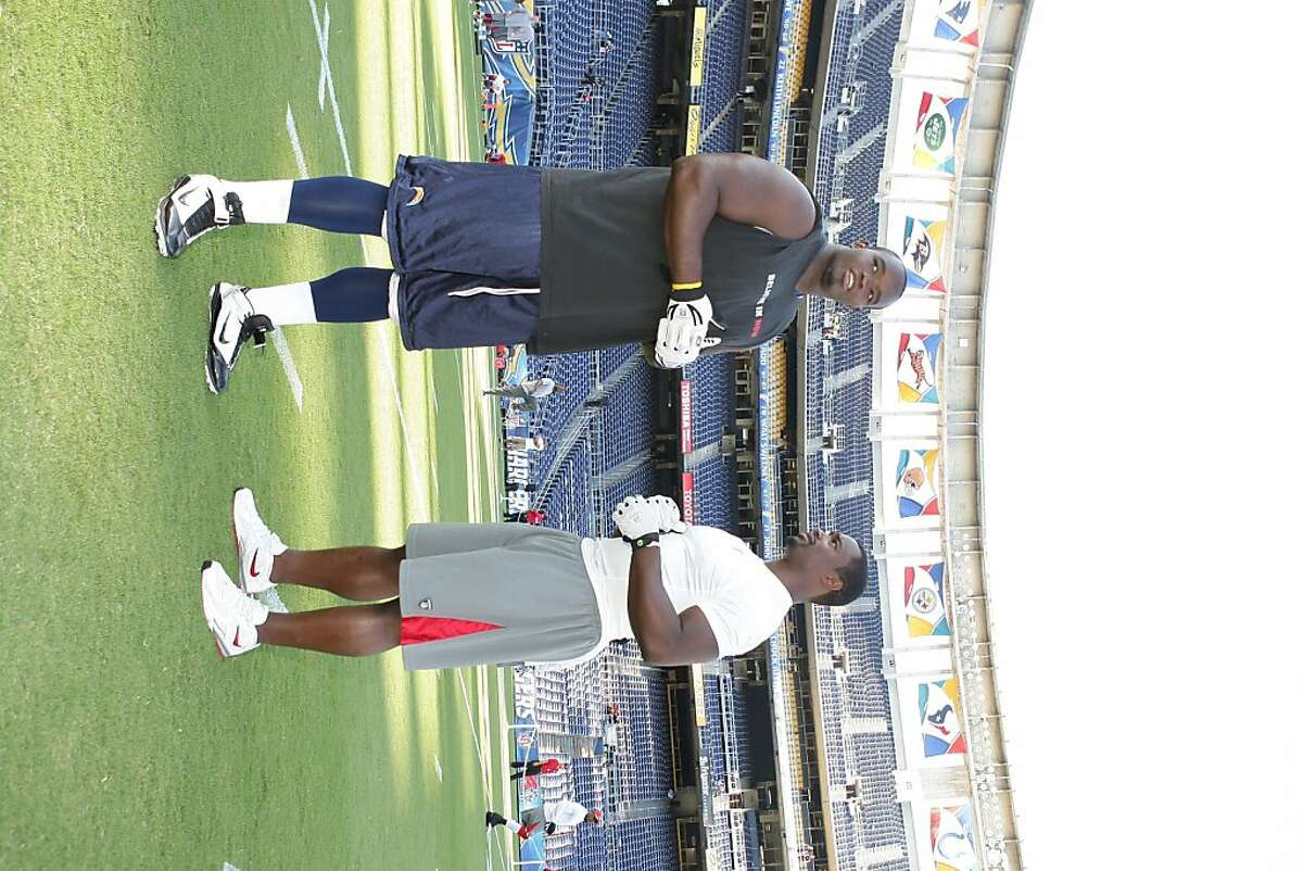 The Chargers' Ogemdi Nwagbuo (left) and 49ers' Xavier Omon are half-brothers. They met for the first time before the teams' preseason game in San Diego on Sept. 1, 2011.