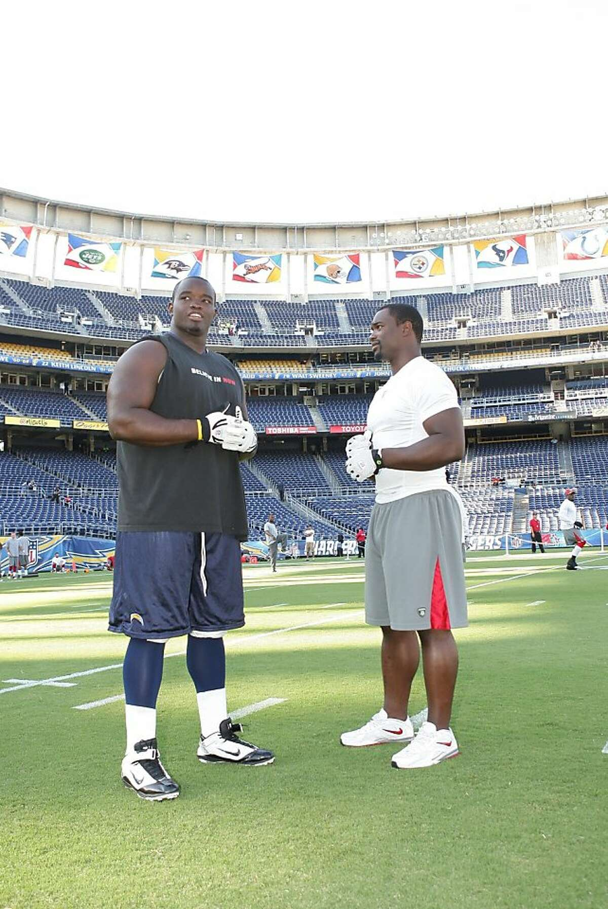 Ogemdi Nwagbuo (right) of the Chargers is half-brother to the 49ers' Xavier Omon. They are shown after meeting for the first time, on Sept. 1, 2011.