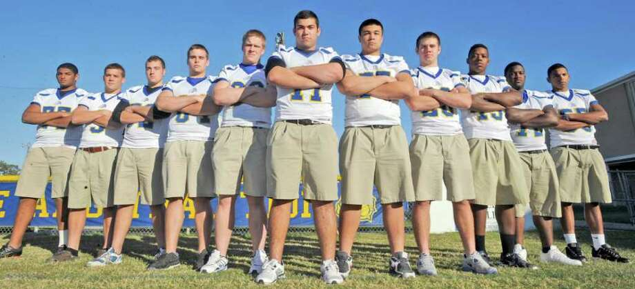 Kelly High School has eleven starting offensive and defensive linemen on the team that is going to the TAPS state Championship game Saturday. From left are, Armando Ledet, William Lighty, John Selman, John Rugg, Ryan Bean, Mark Figueiras, Eddie Scott, Chris Scheurich, Justin Broussard, Gerald Hatch, and James Simon.  Dave Ryan/The Enterprise Photo: Dave Ryan