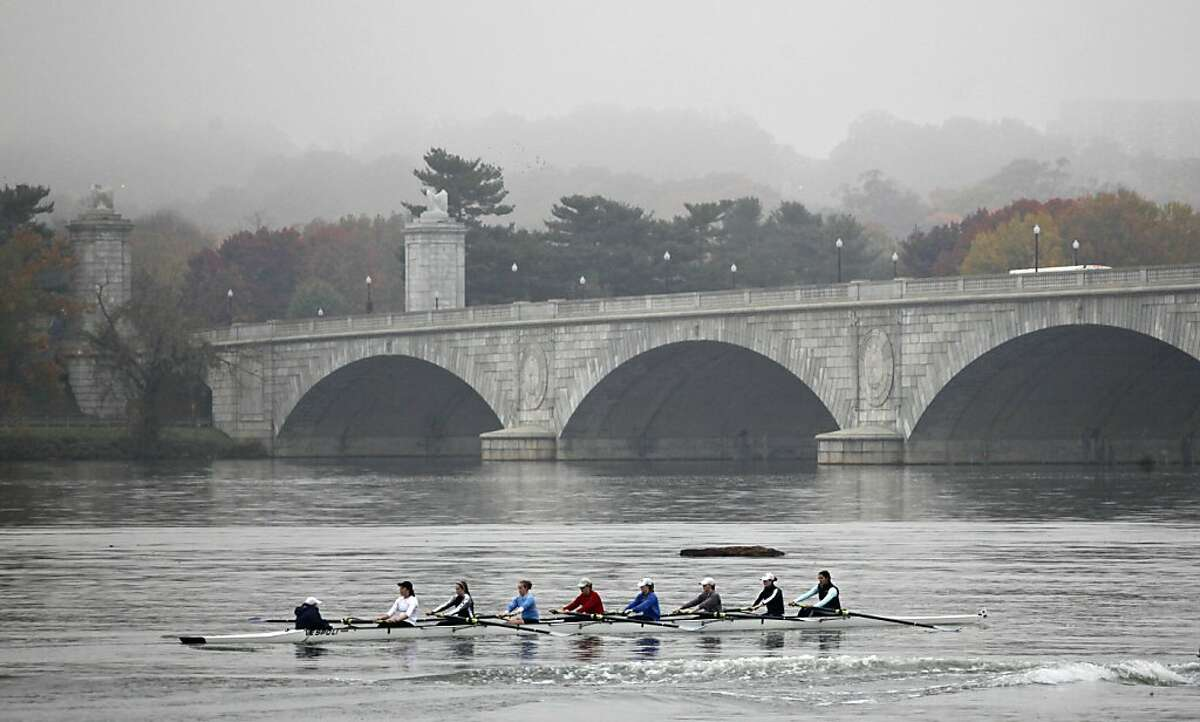 Rowers on the foggy Potomac River approach the Memorial Bridge in Washington, Thursday, Nov. 10, 2011. (AP Photo/J. Scott Applewhite)