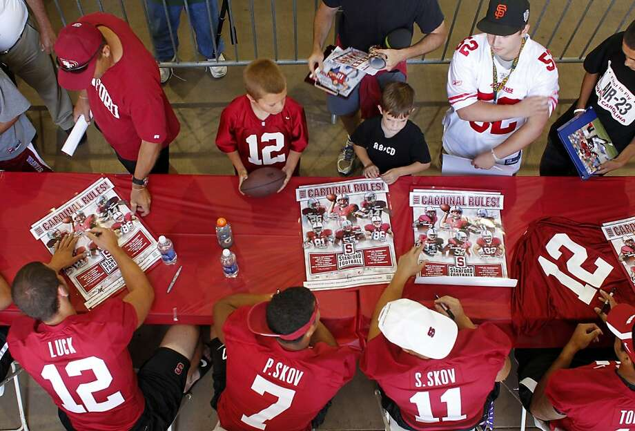 Brothers Patrick, left  and Shayne Skov of the Stanford Football team sign autographs for fans, Sunday August 21, 201, at Stanford's Stadium in Stanford Calif. Photo: Lacy Atkins, The Chronicle