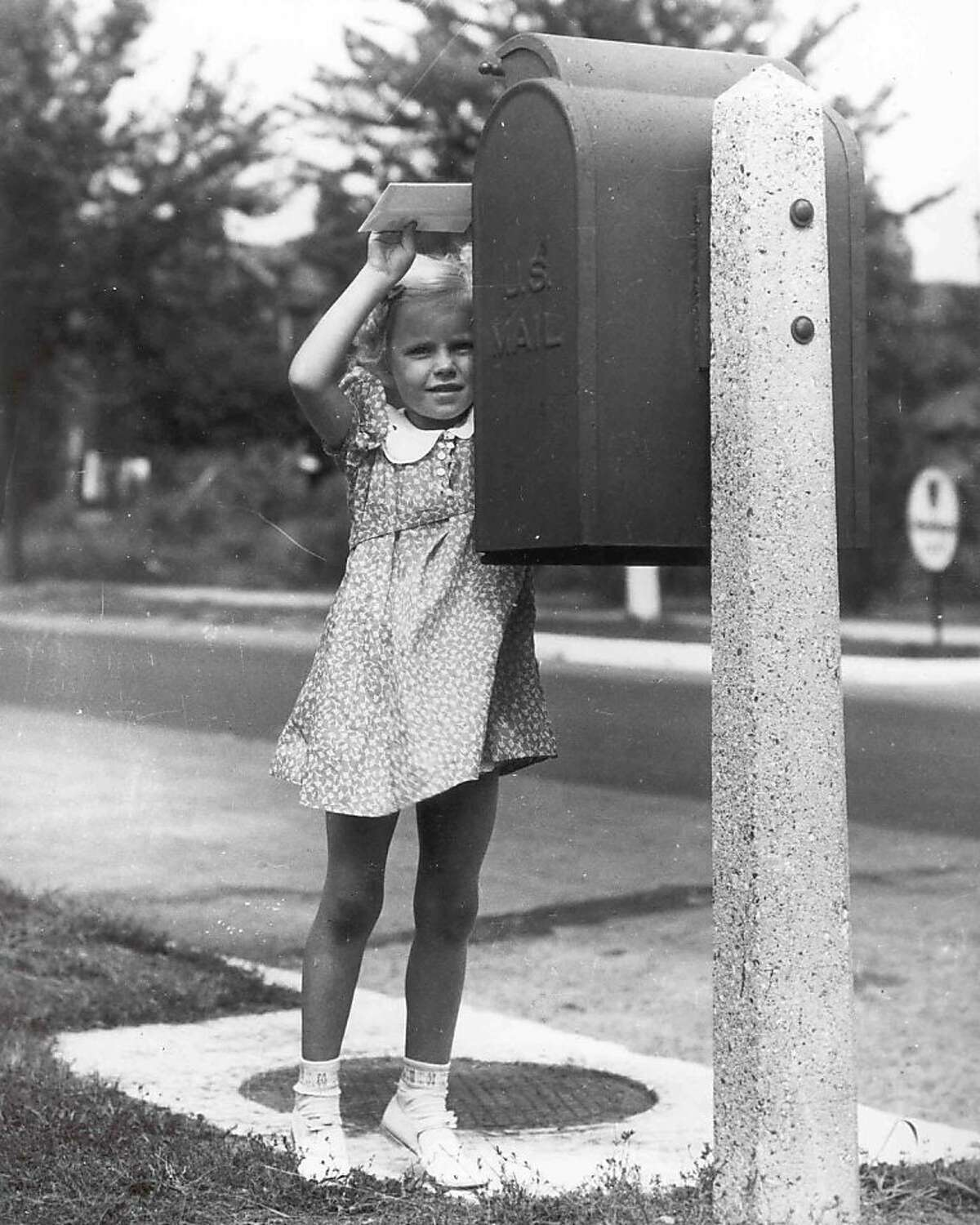 Before the 1950s, mailboxes were affixed to lamp posts.