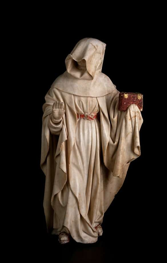 Mourner no.78, with cowl pulled down, right hand raised, left hand holding a book in a flap of his claok, (1443-56/57) Alabaster sculpture by Jean de La Huerta and Antoine le Moiturier    Ran on: 09-01-2011 Mourner No. 78, cowl down, right hand raised, left hand holding a book in flap of cloak, (1443-56-57), alabaster sculpture. Photo: Jared Bendis And Francois Jay