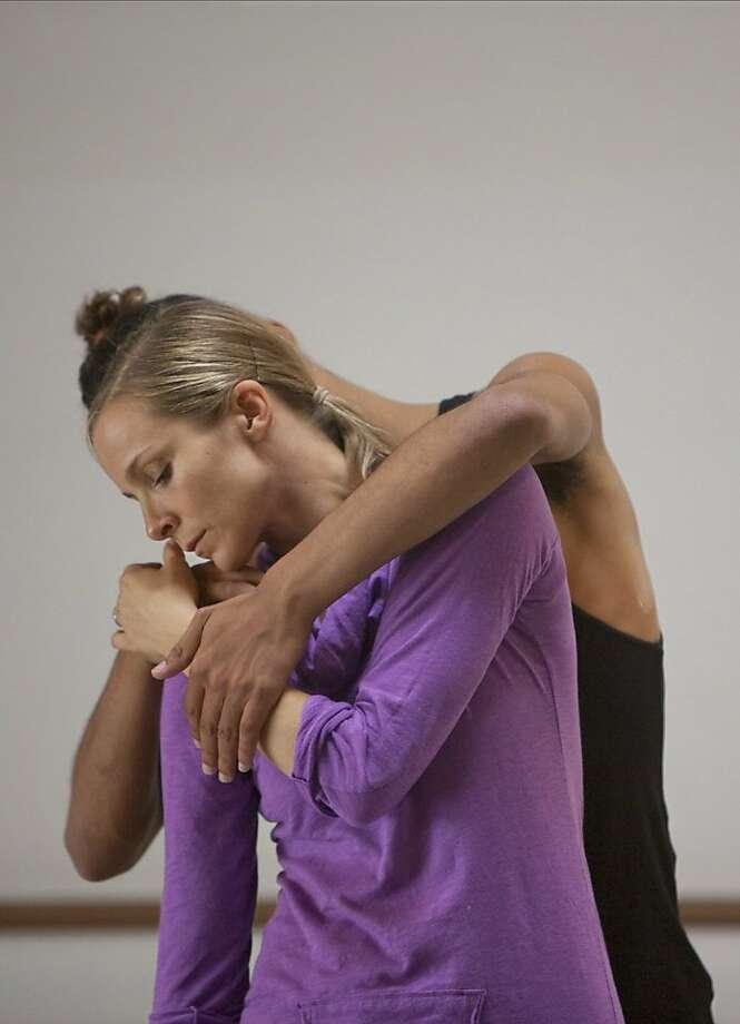 Zhukov Dance Theatre Choreographer: Yuri Zhukov Dancers: Katja Bjorner (in purple shirt) and Sergio Junior Benvindo de Souza Photo: Sandy Lee