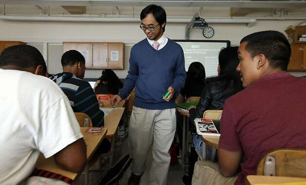 Science teacher Justin Louie at Thurgood Marshall High School walks his students through a physiology assignment Wednesday August 31, 2011 in San Francisco, California. Photo: Lance Iversen, The Chronicle
