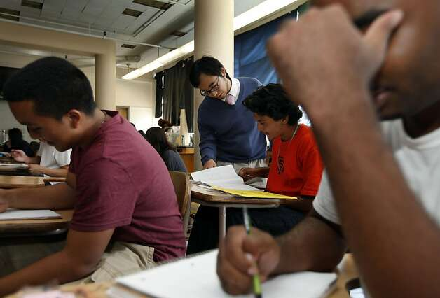 Science teacher Justin Louie (standing center) helps Yovanny Ramirez age 17 with his physiology assignment at Thurgood Marshall High School Wednesday August 31, 2011 in San Francisco, California. Photo: Lance Iversen, The Chronicle