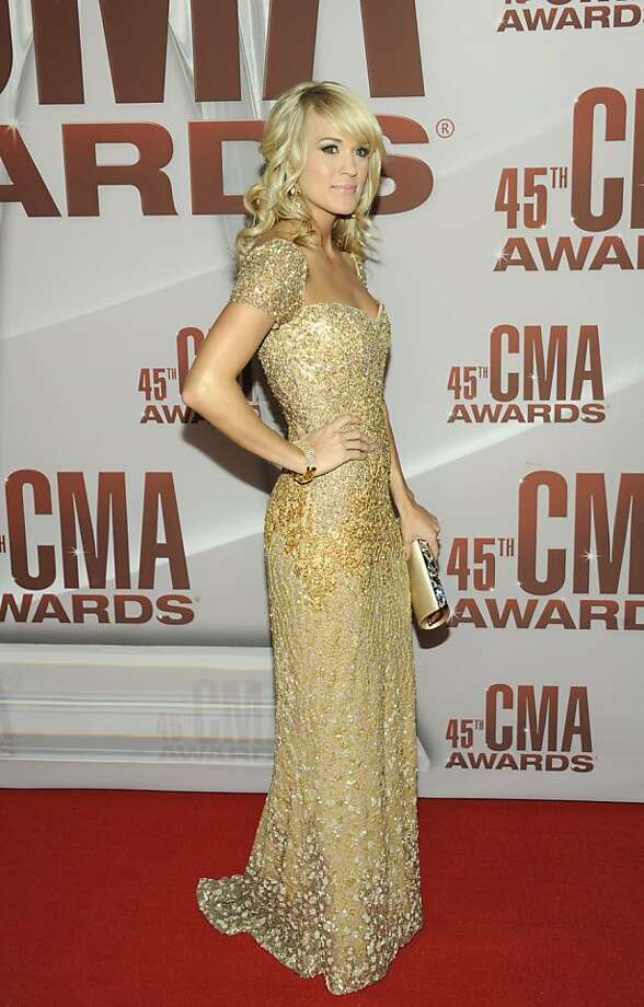 Carrie Underwood arrives at the 45th Annual CMA Awards in Nashville on Wednesday, Nov. 9, 2011. (AP Photo/Evan Agostini) Photo: Evan Agostini, AP