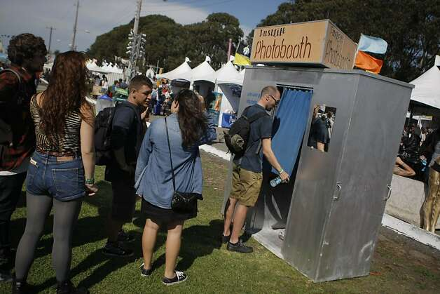 Concert goers waited in line for a photobooth at the Treasure Island Music Festival in San Francisco, Calif., on Saturday, Oct. 15, 2011. Photo: Dylan Entelis, The Chronicle