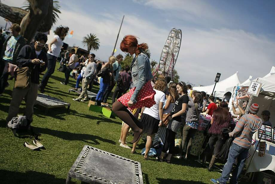 A young woman bounced on a trampoline at the Treasure Island Music Festival in San Francisco, Calif., on Saturday, Oct. 15, 2011. Photo: Dylan Entelis, The Chronicle