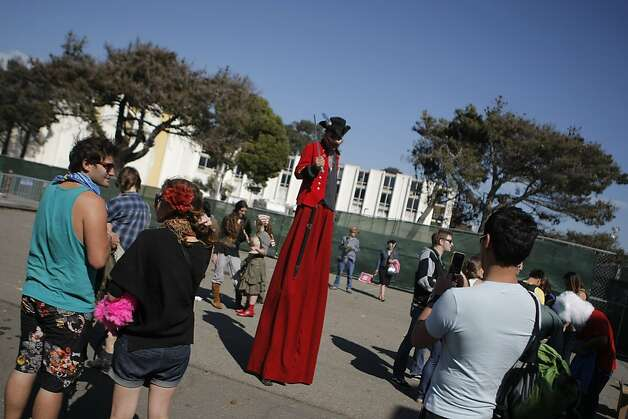 Concert goers are greeted by performers on stilts at the Treasure Island Music Festival in San Francisco, Calif., on Saturday, Oct. 15, 2011. Photo: Dylan Entelis, The Chronicle