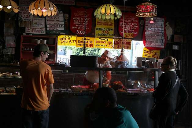 Juan Rubalcaba (middle) has been working at Tommy's Joynt for fourteen years in San Francisco, Calif., and is carving some meat behind the counter on Thursday, August 25, 2011. Photo: Liz Hafalia, The Chronicle