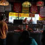 Juan Rubalcaba (middle) has been working at Tommy's Joynt for fourteen years in San Francisco, Calif., and is carving some meat behind the counter on Thursday, August 25, 2011.