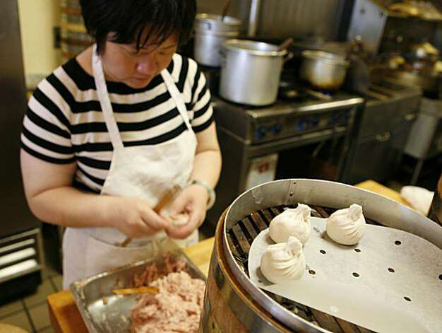 Dumplings are filled and formed by hand prior to steaming at the Shanghai Dumpling Shop, 455 Broadway, in Millbrae, CA. Photo by Michael Maloney / San Francisco Chronicle   *** Ran on: 07-05-2007 Dumplings are formed by hand at the Shanghai Dumpling Shop, above. At right, Henry Chu sells stylish, energy-efficient lights at Halogens. Ran on: 09-10-2008 Photo: Michael Maloney, SFC