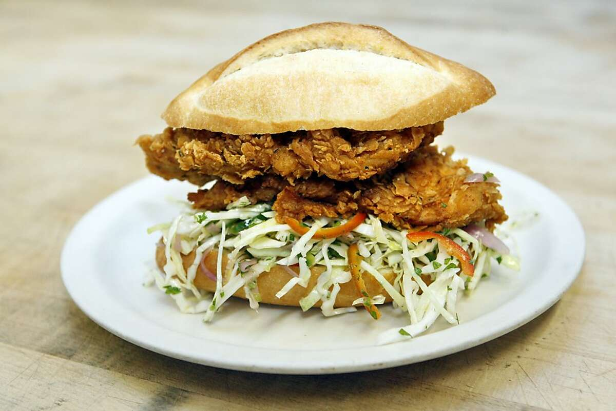 CHEF01_033_RAD.jpg SHOWN: The famous and elicious fried chicken sandwich from Bakesale Betty, the pie and sandwich shop in Oakland. Betty is the alter ego of Alison Barakat, who, with her husband Michael Camp, runs Bakesale Betty. Bakesale Betty is the name of the pie and sandwich shop in Oakland, CA. (Katy Raddatz/The Chronicle) **Bakesale Betty, Alison Barakat, Michael Camp Ran on: 10-14-2010 The fried chicken sandwich packed with spicy coleslaw draws crowds to Bakesale Betty in Oakland.