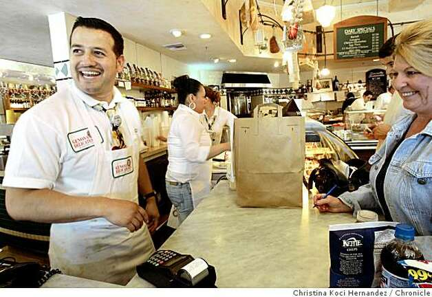 Manager Julio de la Cruz helps customers during busy lunch time rush at Genova Delicatessen and Ravioli Factory. Photo: Christina Koci Hernandez, Chronicle