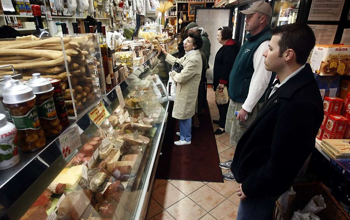 Customers wait in the narrow aisle to order sandwiches at Lucca Delicatessen on Chestnut Street in San Francisco, Calif., on Friday, April 2, 2010. Ran on: 10-14-2010 Customers wait in the narrow aisle to order sandwiches at Lucca Delicatessen in S.F.