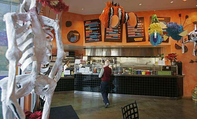 La Calaca Loca Taqueria in Oakland  Kurt Rogers Oakland SFC The Chronicle BARGAIN24_LACALACALOCA_00003_kr.JPGRan on: 02-23-2006 La Calaca Loca Taqueria in Oakland's Temescal neighborhood serves up modern, healthier takes on Mexican fast food in a skeleton-themed 50-seat cafe. Ran on: 05-31-2007 San Ramon's Incontro co-owner Luigi Troccoli serves guests Bill Hilton (from left), Shelley Hilton and Cathy Wilkins. Photo: Kurt Rogers, SFC