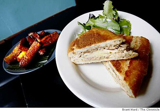 At Paladar, the Sandwich Cubano (right) is often paired with platanos maduros (left). Paladar is a small Cuban restaurant on Kearny Street between Bush and Pine Streets in San Francisco, CA. Photo: Brant Ward, The Chronicle
