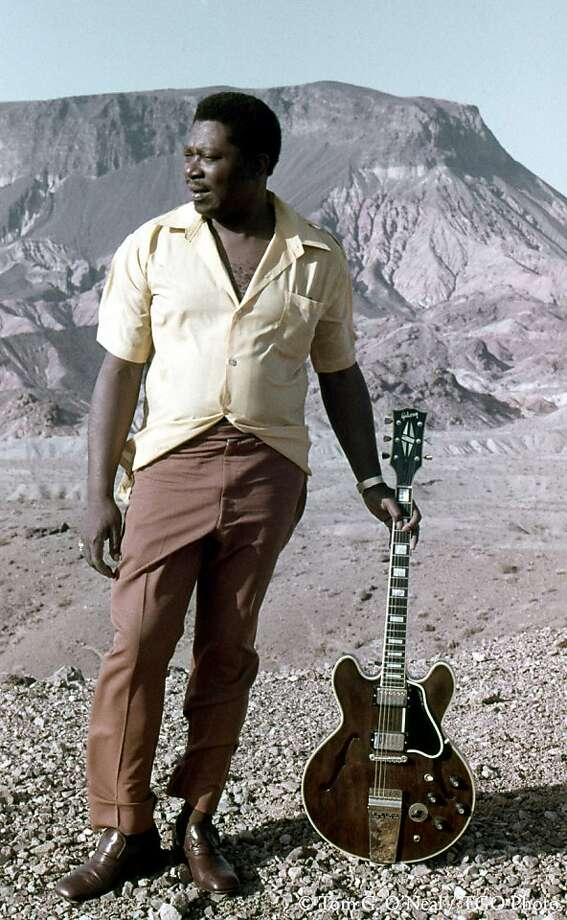 "Photographer Tom G. O'Neal said he was a ""longhaired, bell-bottom-wearing hippie"" when he picked up guitarist B.B. King at the Aladdin Hotel and drove 30 miles outside of Las Vegas for this 1972 photo shoot for King's ""Guess Who"" album. ""I felt I was with a refined Southern gentleman ... it took a while to connect with him,"" O'Neal recalled, adding that eventually King relaxed -- and even took his pointy shoes off. Photo: Tom G. O'Neal, TGO Photo"