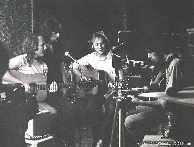 "CSNY -- David Crosby (far left), Stephen Stills (center right), Graham Nash (center left) and Neil Young (far right) -- rehearse in Studio City in 1969 for Woodstock. ""They renovated Peter Tork's garage by hanging oriental rugs up on the walls for sound,"" recalled photographer Tom O'Neal. Photo: Tom G. O'Neal, TGO Photo"