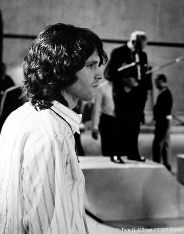 "The Nelson Riddle Orchestra is in the background as Jim Morrison, the lead singer of the Doors, rehearses for ""The Smothers Brothers Comedy Hour."" After photographer Tom G. O'Neal left the rock scene in the mid-1970s, he ""pretty much got out of the loop"" and left piles of proof sheets unexamined for years. His rarely seen rock images will be on view at Mountainsong Galleries in Carmel Dec. 3-Jan. 30. Photo: Tom G. O'Neal, TGO Photo"