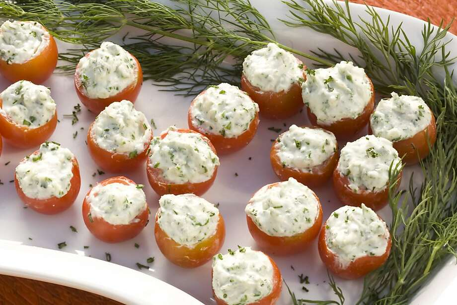 Food for summer entertaining, cherry tomatoes with herbed goat cheese, in San Francisco, Calif., on June 10, 2008. Food styled by Maryann Smitt. Photo by Craig Lee / The Chronicle Ran on: 06-18-2008 Photo: Photo By Craig Lee, SFC