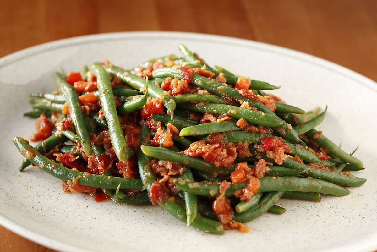 Sauteed green Beans with Warm Tomato, Bacon and Shallot Dressing in San Francisco, Calif., on July 28, 2010. Food styled by Britt Billmaier. Ran on: 09-12-2010 Photo caption Dummy text goes here. Dummy text goes here. Dummy text goes here. Dummy text goes here. Dummy text goes here. Dummy text goes here. Dummy text goes here. Dummy text goes here.###Photo: REBOOT12_ph1280188800SFC###Live Caption:Sauteed green Beans with Warm Tomato, Bacon and Shallot Dressing in San Francisco, Calif., on July 28, 2010. Food styled by Britt Billmaier.###Caption History:Sauteed green Beans with Warm Tomato, Bacon and Shallot Dressing in San Francisco, Calif., on July 28, 2010. Food styled by Britt Billmaier.###Notes:Craig Lee 415-218-8597 (cell phone)_craig@craigleephoto.com###Special Instructions:MANDATORY CREDIT FOR PHOTOG AND SF CHRONICLE-NO SALES-MAGS OUT-INTERNET__OUT-TV OUT