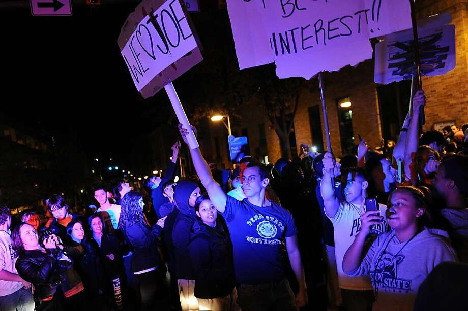 STATE COLLEGE, PA - NOVEMBER 9: Students and those in the community fill the streets and react after football head coach Joe Paterno was fired during the Penn State Board of Trustees Press Conference, in downtown Penn State, November 9, 2011 in State College, Pennsylvania. (Photo by Patrick Smith/Getty Images) Photo: Patrick Smith, Getty Images
