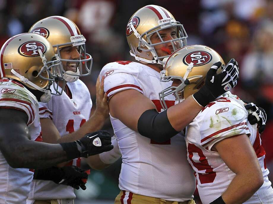 San Francisco 49ers fullback Bruce Miller, right, celebrates his touchdown with teammates, from left, Delanie Walker, Alex Smith and Joe Staley in the first half of an NFL football game against the Washington Redskins in Landover, Md., Sunday, Nov. 6, 2011. (AP Photo/Pablo Martinez Monsivais) Photo: Pablo Martinez Monsivais, AP