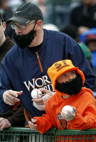 Brian Estabrook, of Livermore, and his son Timothy seek autographs from players before the Giants spring training baseball game against the Colorado Rockies was cancelled because of rainy and wet conditions in the 3rd inning at Scottsdale Stadium in Scottsdale, Ariz. on Monday, March 21, 2011.   Ran on: 03-23-2011 Brian Estabrook of Livermore and his son Timothy are in bearded midseason form. Photo: Paul Chinn, The Chronicle