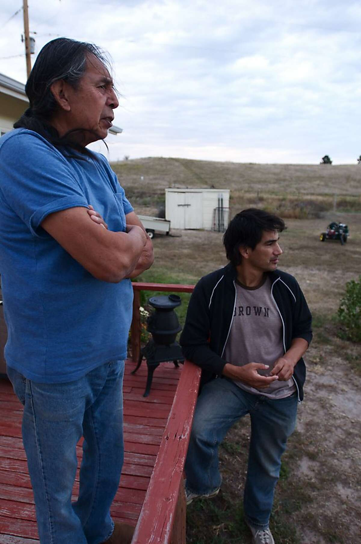 """Walter Littlemoon at his Wounded Knee home with Randy Vasquez, director of """"A Thick Dark Fog,"""" showing at the American Indian Film Festival."""
