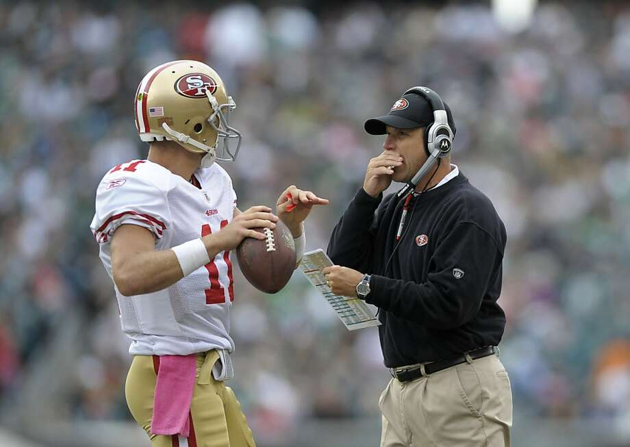 San Francisco 49ers quarterback Alex Smith (11) talking to coach Jim Harbaugh in the first half of an NFL football game against the Philadelphia Eagles, Sunday, Oct. 2, 2011, in Philadelphia. The 49ers won 24-23. (AP Photo/Michael Perez) Photo: Michael Perez, AP