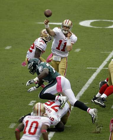 San Francisco 49ers quarterback Alex Smith (11) throws a pass in the first half of an NFL football game with the Philadelphia EaglesSunday, Oct. 2, 2011 in Philadelphia. (AP Photo/Julio Cortez) Photo: Julio Cortez, AP
