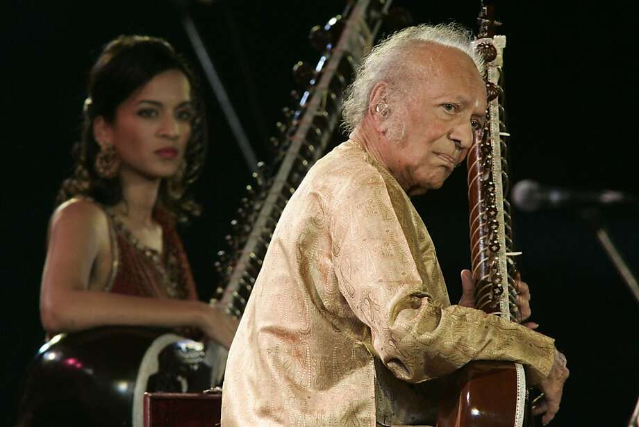Legendary sitar player Ravi Shankar, right, performs with his daughter Anoushka Shankar in Calcutta, India, Saturday, Feb. 7, 2009. (AP Photo/Bikas Das) Photo: Bikas Das, ASSOCIATED PRESS