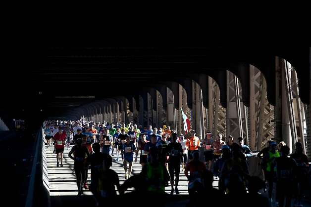 Runners jog across the Queensboro Bridge while competing in the New York City Marathon, Sunday, Nov. 6, 2011. (AP Photo/Andrew Burton) Photo: Andrew Burton, AP