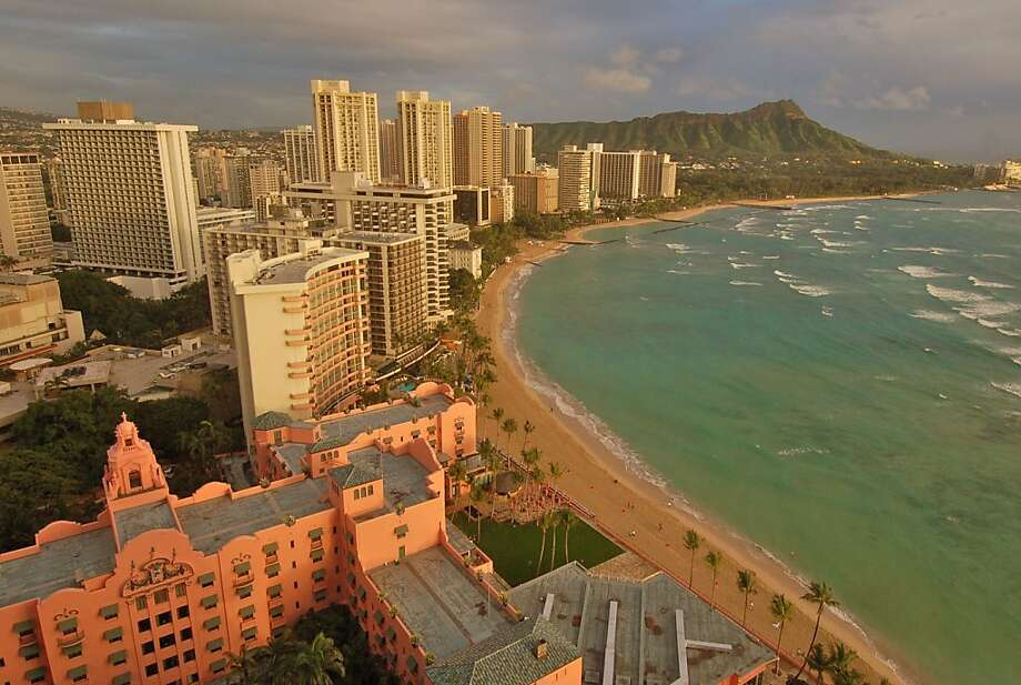 Both the iconic pink Royal Hawaiian and the Sheraton Waikiki, from which this photo was taken, will host APEC meetings next week, although the proximity of the beach will surely be a temptation to attendees. Photo: Jeanne Cooper, Special To SFGate