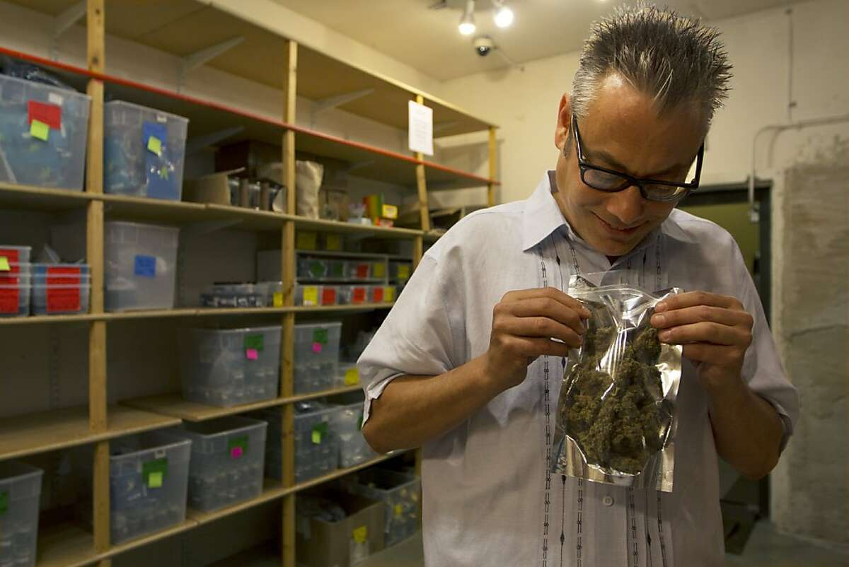 Andrew DeAngelo examines an ounce of high-grade medical cannabis on,